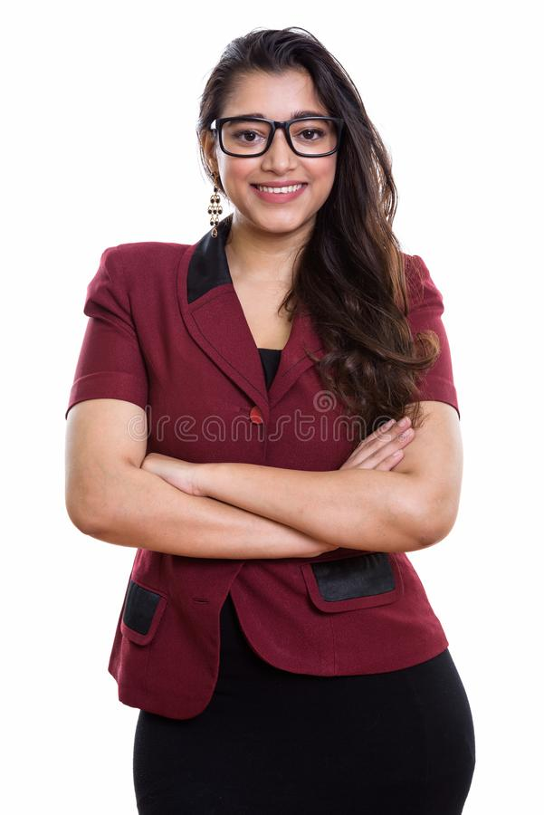 Young happy Indian businesswoman smiling with arms crossed stock image