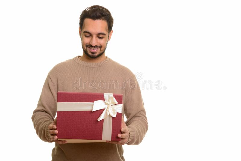 Young happy Indian man opening gift box ready for Valentine`s da. Y stock images