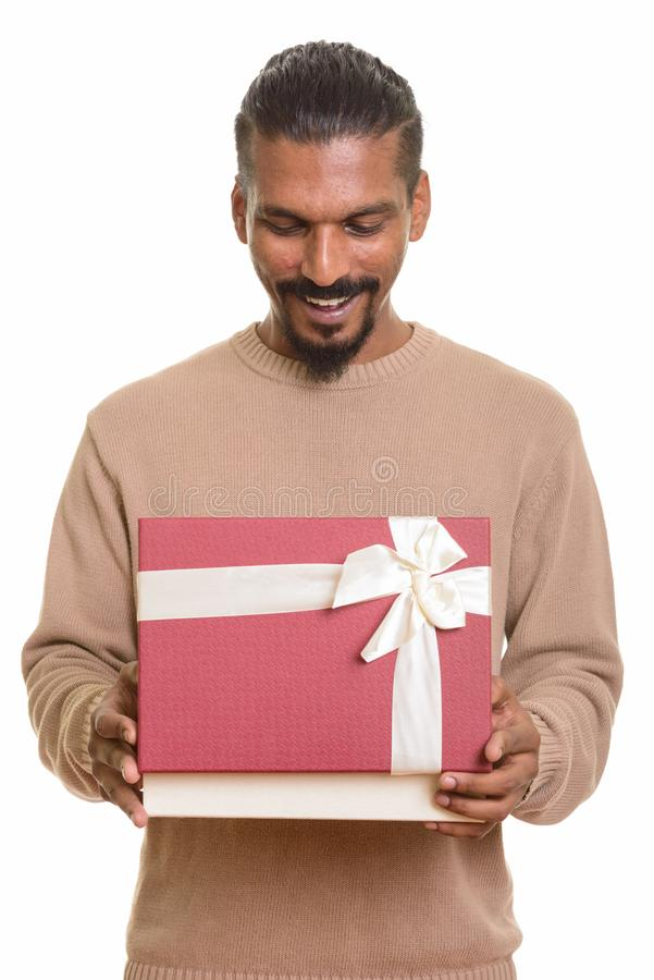Young happy Indian man opening gift box ready for Valentine`s da. Y royalty free stock photography