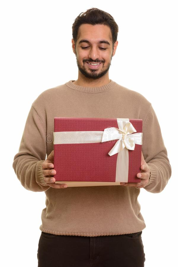 Young happy Indian man opening gift box ready for Valentine`s da. Y royalty free stock photos
