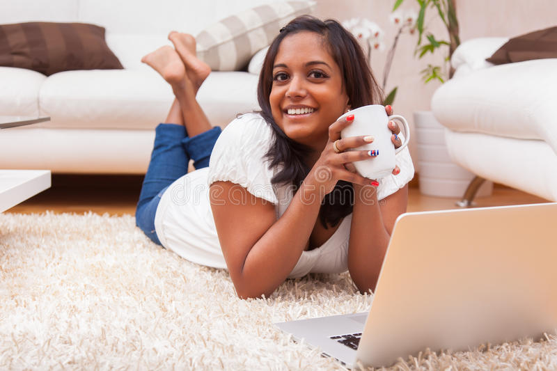 Download Young Happy Indian Woman Using A Laptop Stock Image - Image of leisure, mixed: 29058023