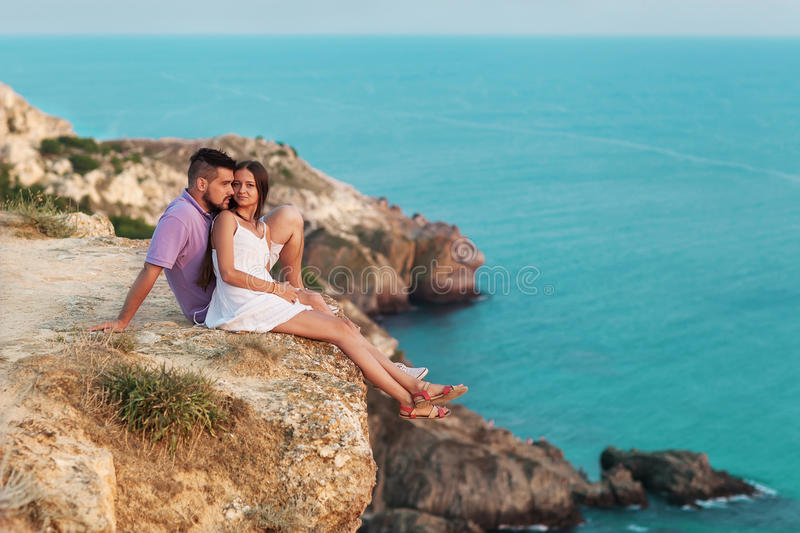 Young happy interracial couple on beach stock image