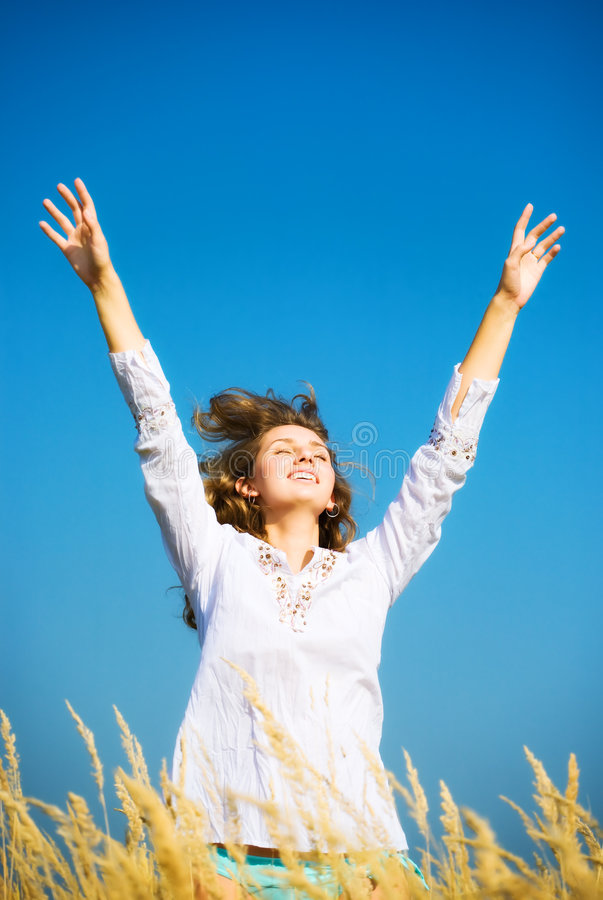 Young happy jumping woman royalty free stock photography