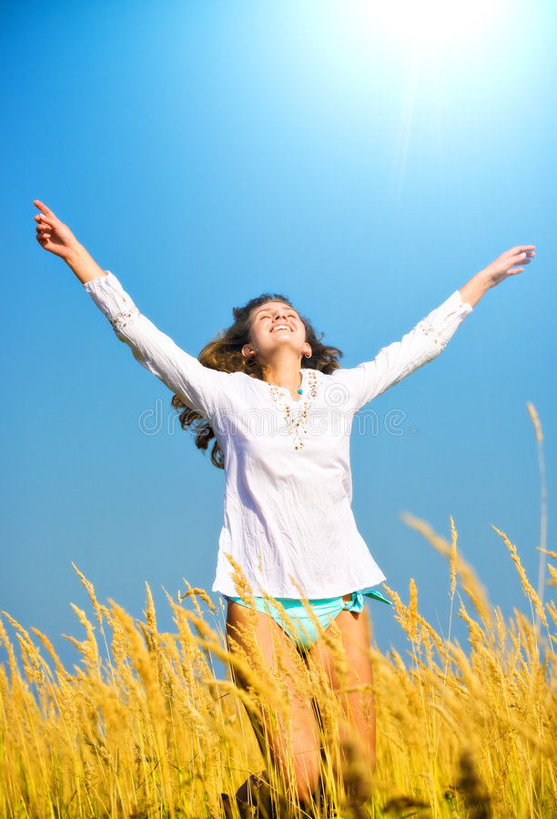 Young happy jumping woman stock photo