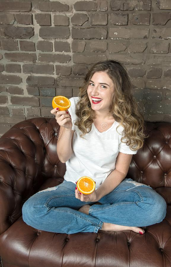 Young happy laughing woman Cheerful girl fruit Healthy eating stock photography