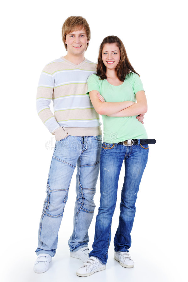 Young happy loving couple standing together