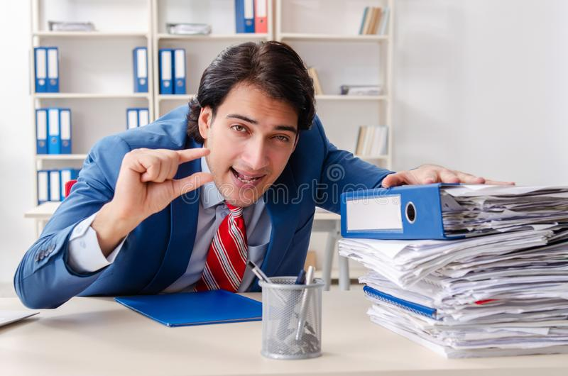 The young happy male employee in the office royalty free stock images