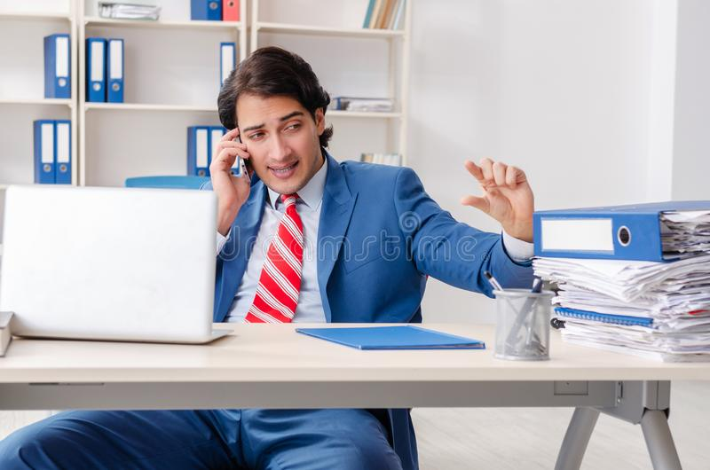 The young happy male employee in the office royalty free stock image