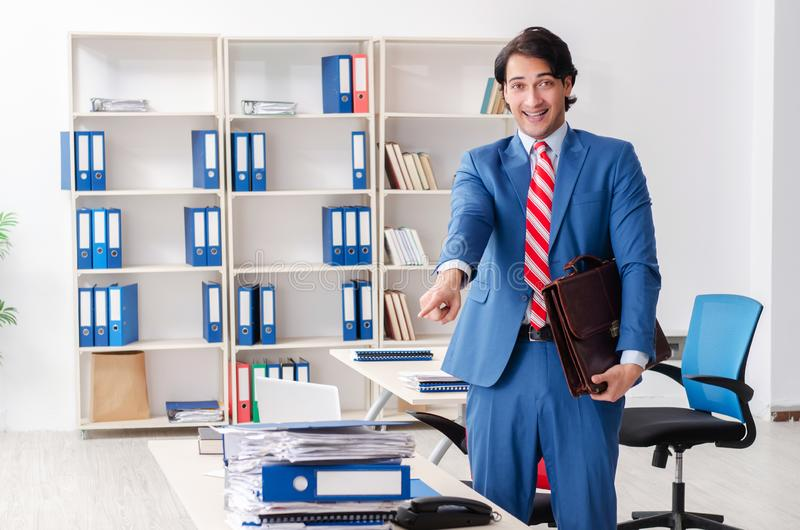The young happy male employee in the office stock images