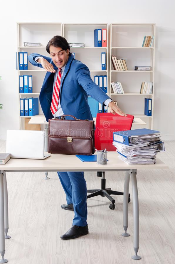 Young happy male employee in the office royalty free stock image
