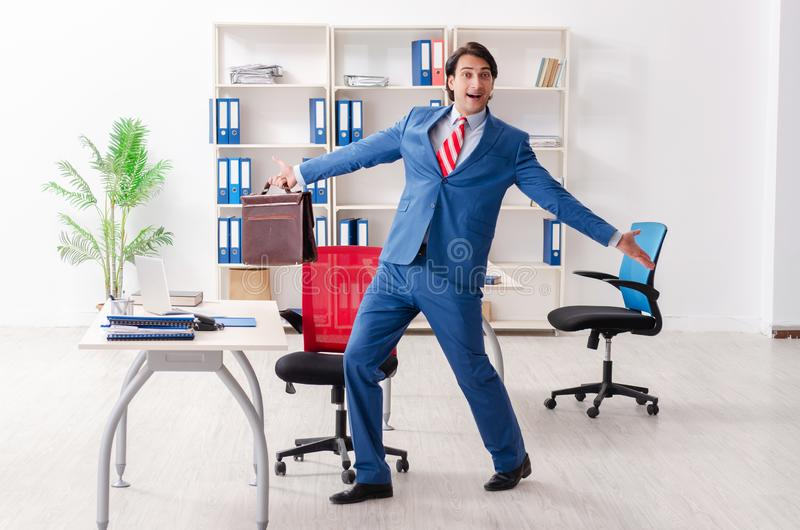 The young happy male employee in the office stock photos