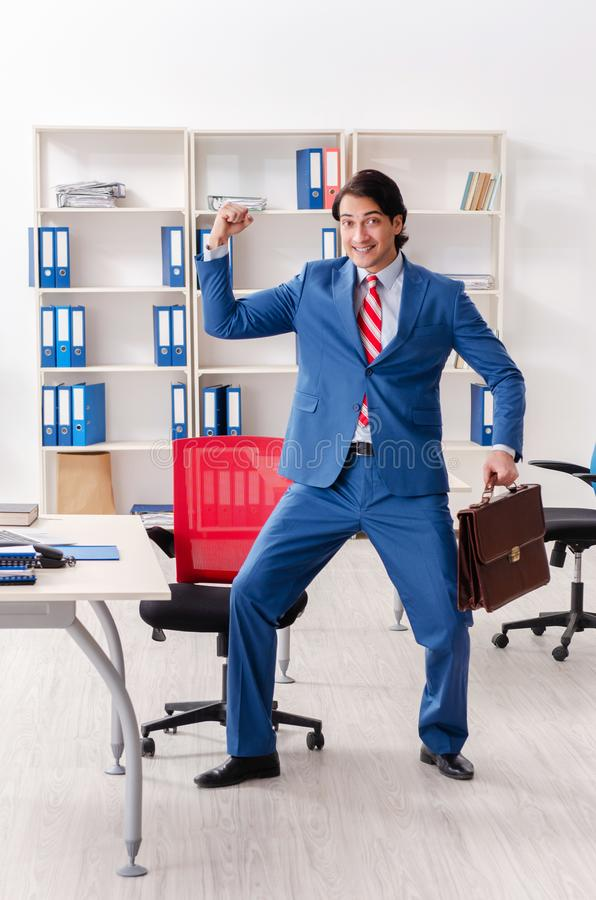 The young happy male employee in the office royalty free stock photography