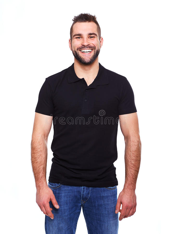 Young happy man in a black polo shirt. On white background stock images