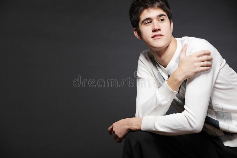 Young happy man possing in studio. royalty free stock image