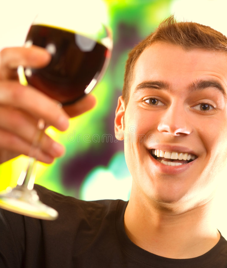 Young happy man with red wine stock image