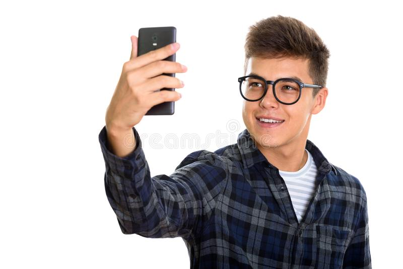 Young happy man smiling while taking selfie picture mobile phone royalty free stock photo