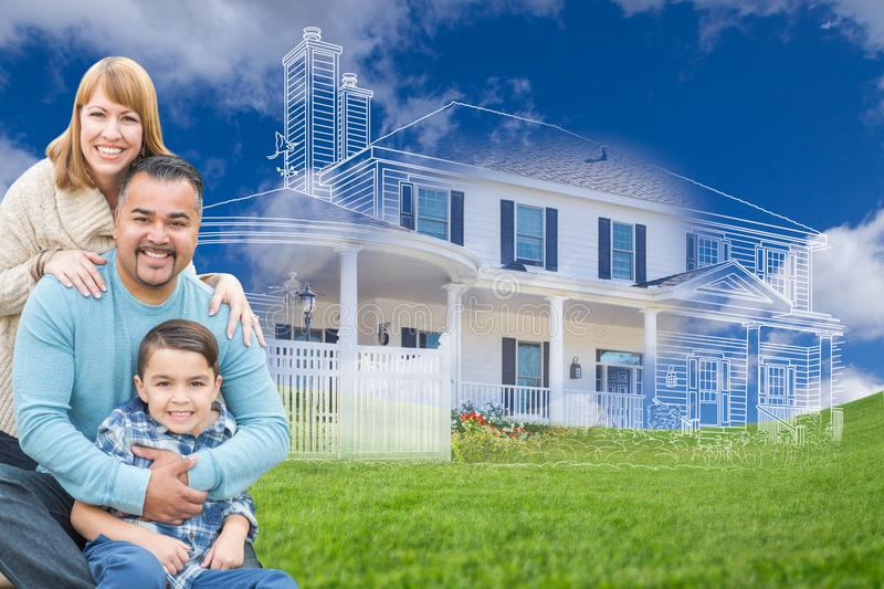 Young Mixed Race Family and Ghosted House Drawing on Grass. Young Happy Mixed Race Family and Ghosted House Drawing on Grass royalty free stock photography