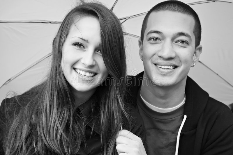 Young happy multi-racial attractive couple stock image