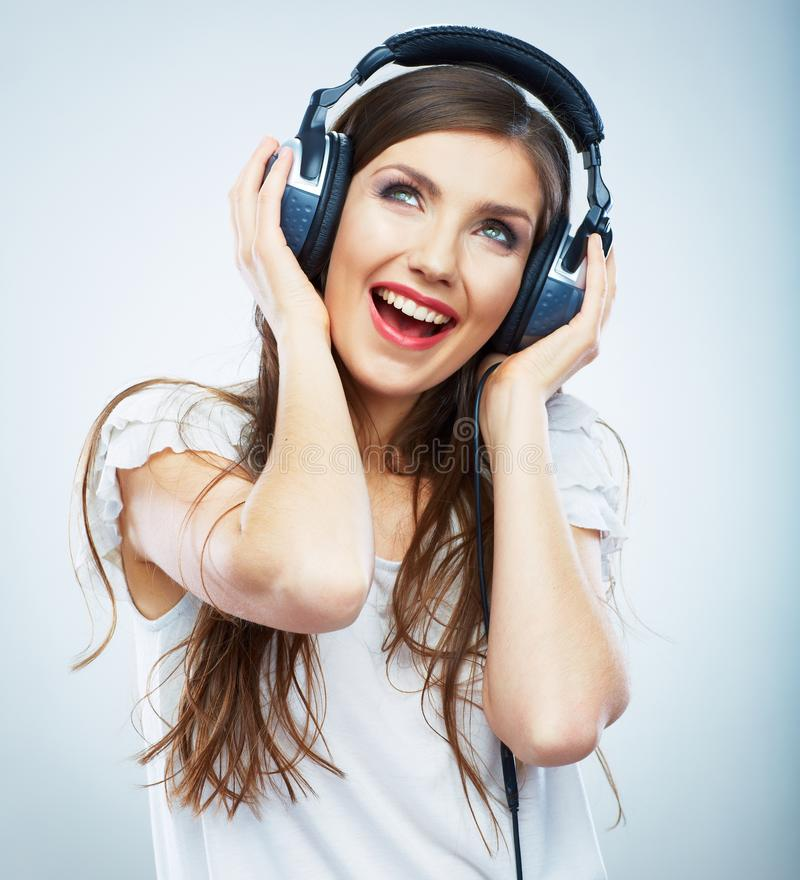 Young Happy Music woman isolated portrait. Female model studio royalty free stock images