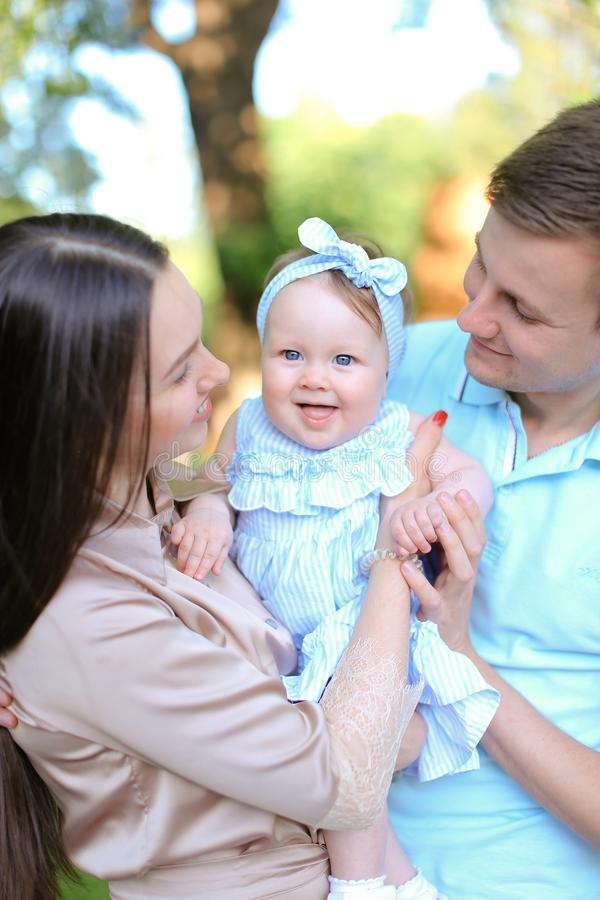 Young happy parents holding little daughter. stock images