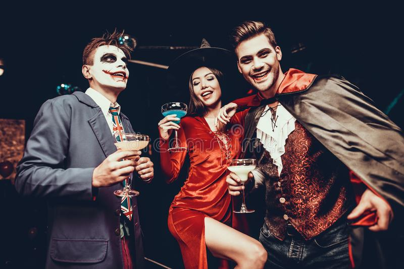 Young Happy People in Costumes at Halloween Party royalty free stock image