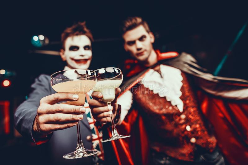 Young Happy People in Costumes at Halloween Party royalty free stock photo