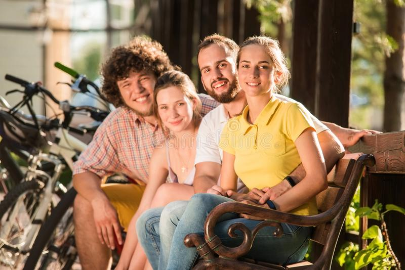 Young happy people resting outdoors. stock image