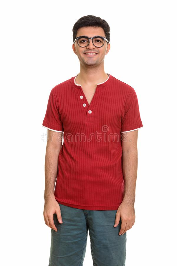 Young happy Persian man smiling and looking at camera stock images