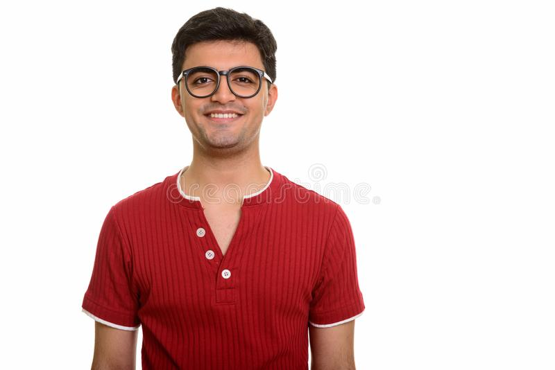 Young happy Persian man smiling and looking at camera royalty free stock image