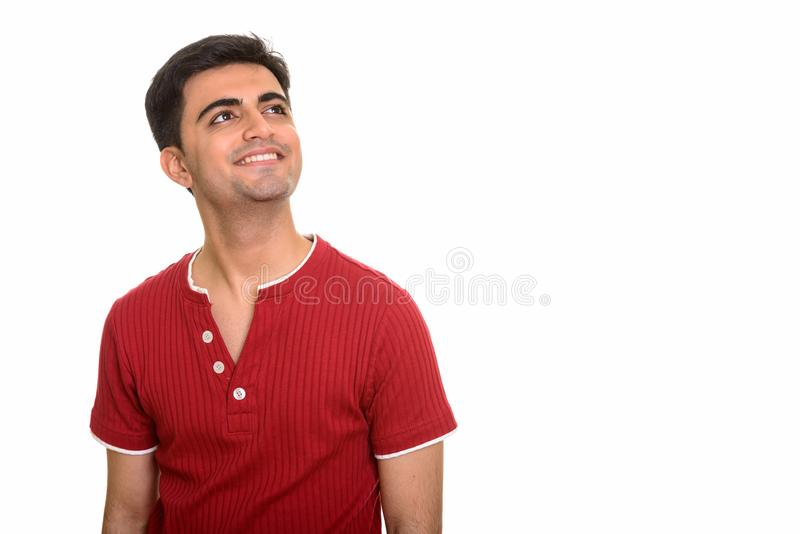 Young happy Persian man thinking and smiling royalty free stock photos