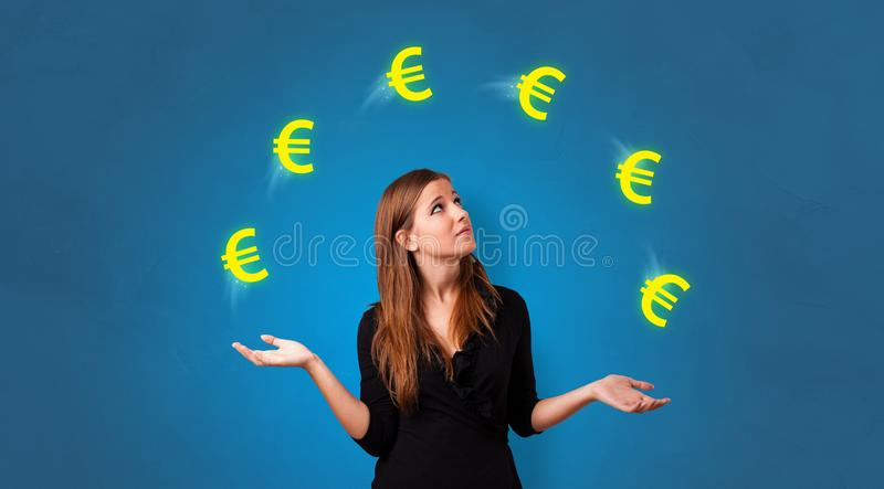 Person juggle with euro symbol royalty free stock photo