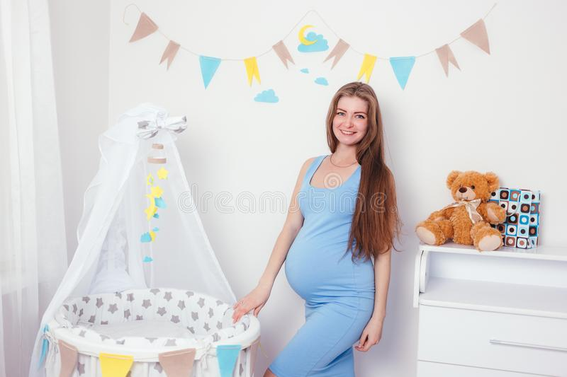 Young and happy pregnant woman expecting a baby royalty free stock images