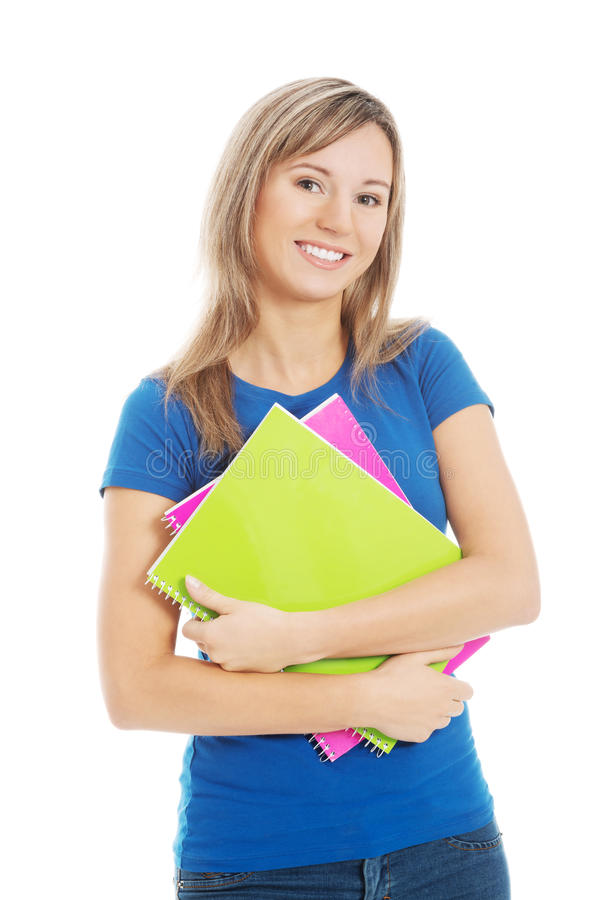 Young happy and satisfied student holding workbook. stock photo