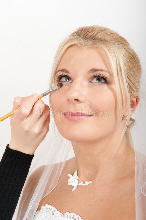 Young happy bride with perfect bridal make-up royalty free stock image