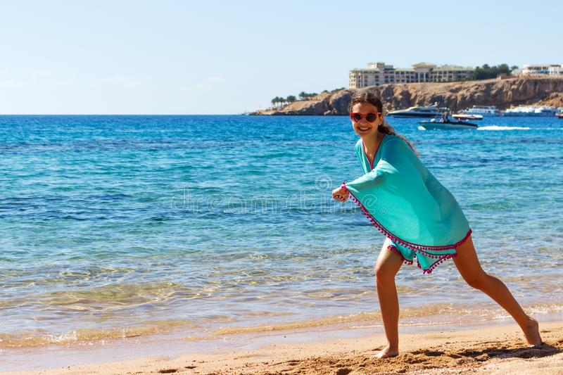 Young happy slim beautiful woman on the beach, playful, dancing, running and having fun in summer vacation royalty free stock photos