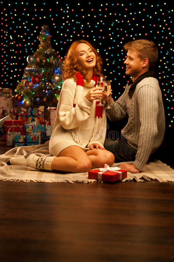 Young happy smiling casual couple with wineglasses stock photo