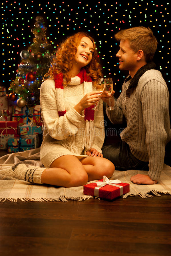 Young happy smiling casual couple with wineglasses royalty free stock photography
