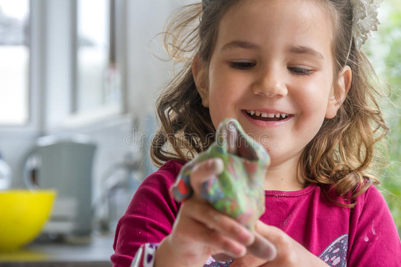 Young happy smiling caucasian child girl play stock photo