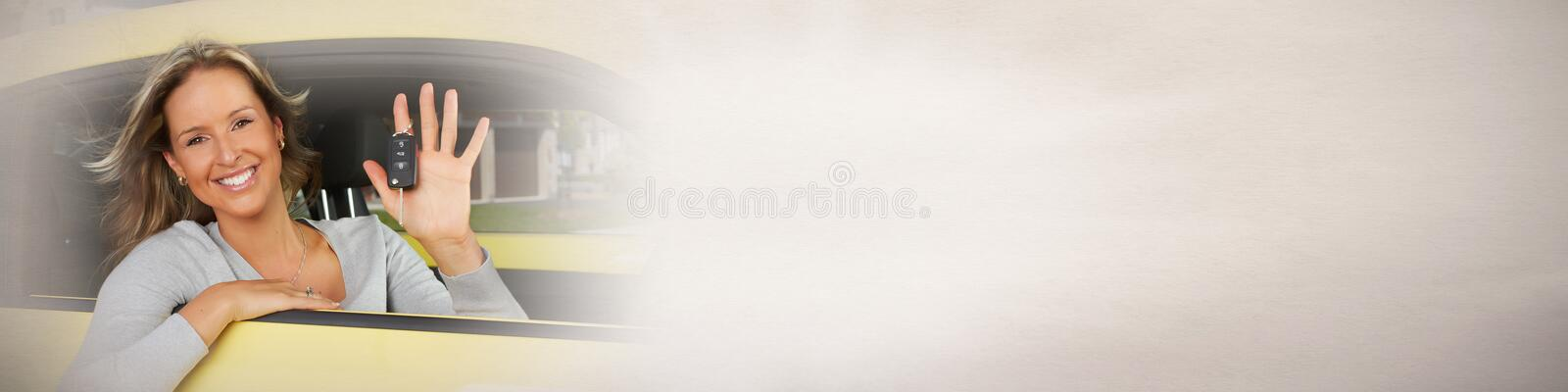 Driver woman. Young happy smiling driver girl with car key stock image