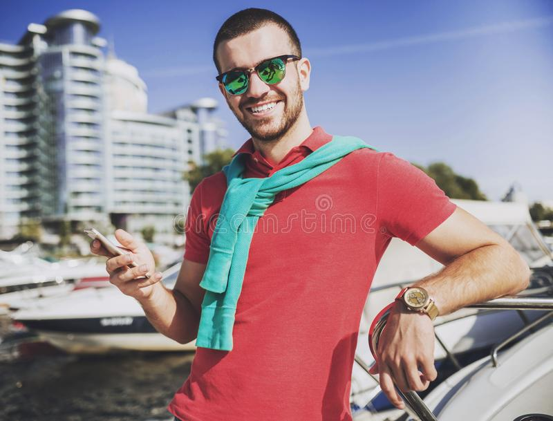 Young Happy Smiling Man in Glasses in Yacht Club. stock photo