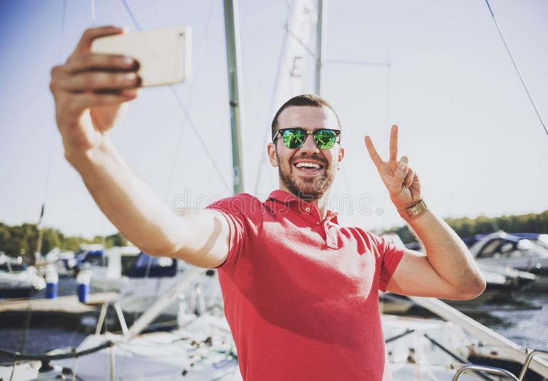 Young Happy Smiling Man in Glasses in Yacht Club. stock photos