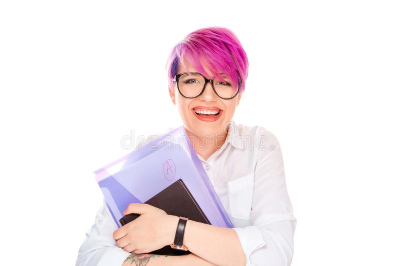 Young happy smiling woman with folder with A grade on white. Portrait of young happy smiling student girl woman with books folder with A grade on it isolated on stock photos