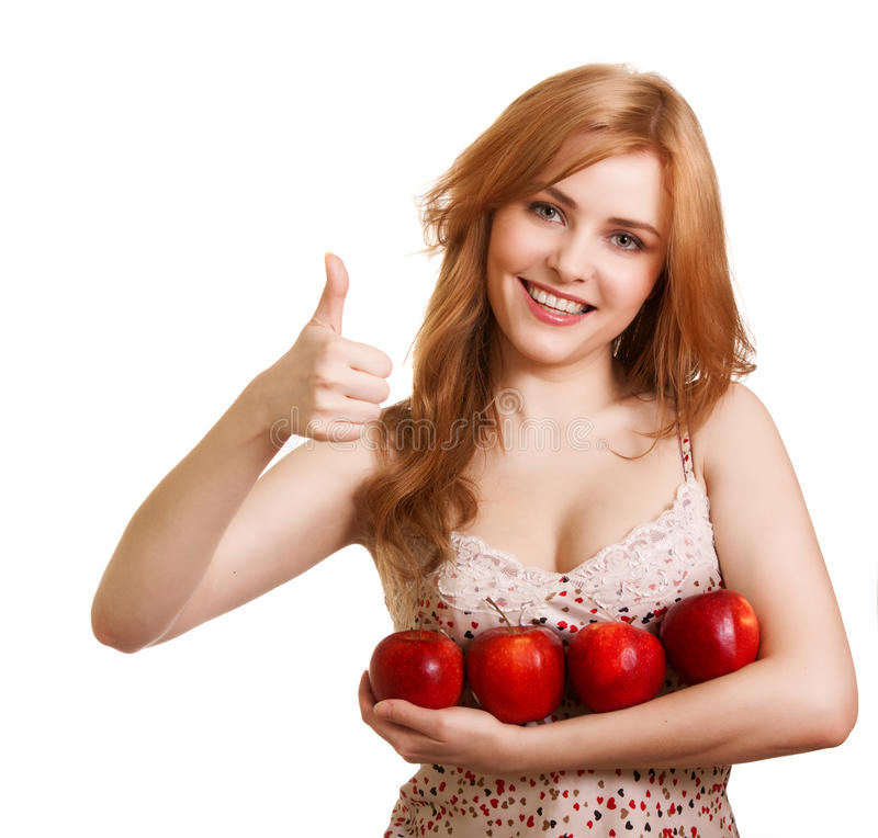 Young happy smiling woman with four red apple royalty free stock image
