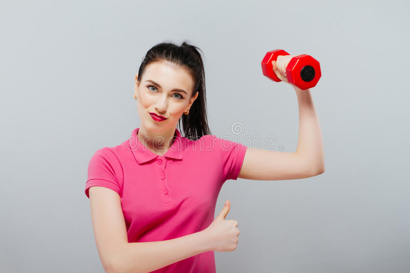 Young happy smiling woman in sportswear. Girl is pretty and fashion. good resaults royalty free stock photos