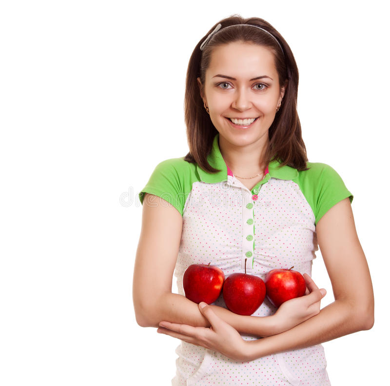 Young happy smiling woman with three red apple. Isolated on white royalty free stock image
