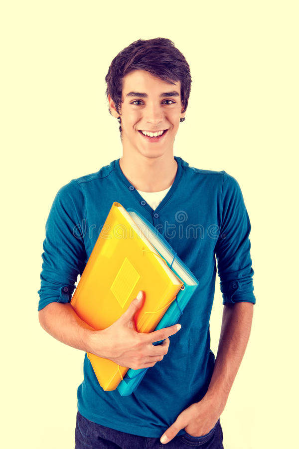 Young happy student carrying books stock image