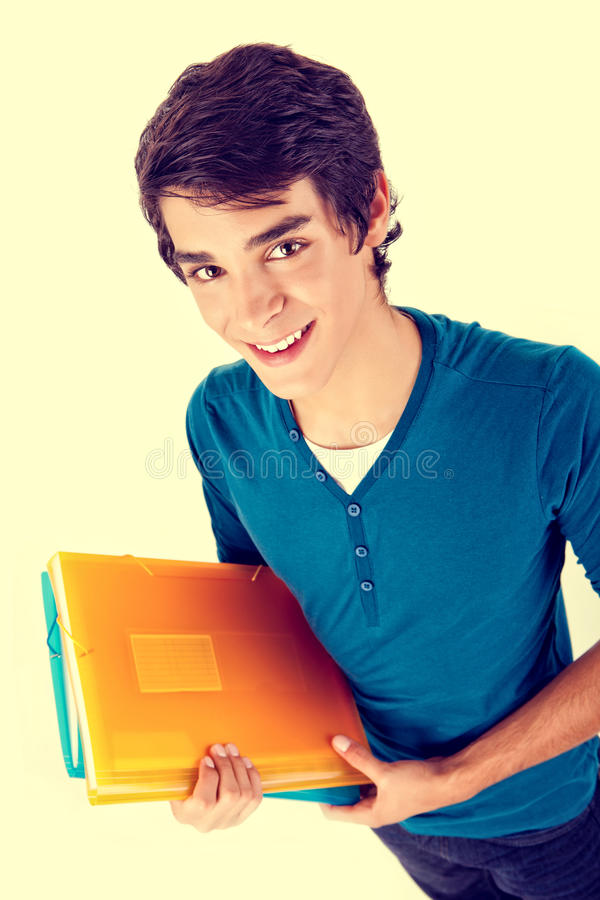 Young happy student carrying books stock photography