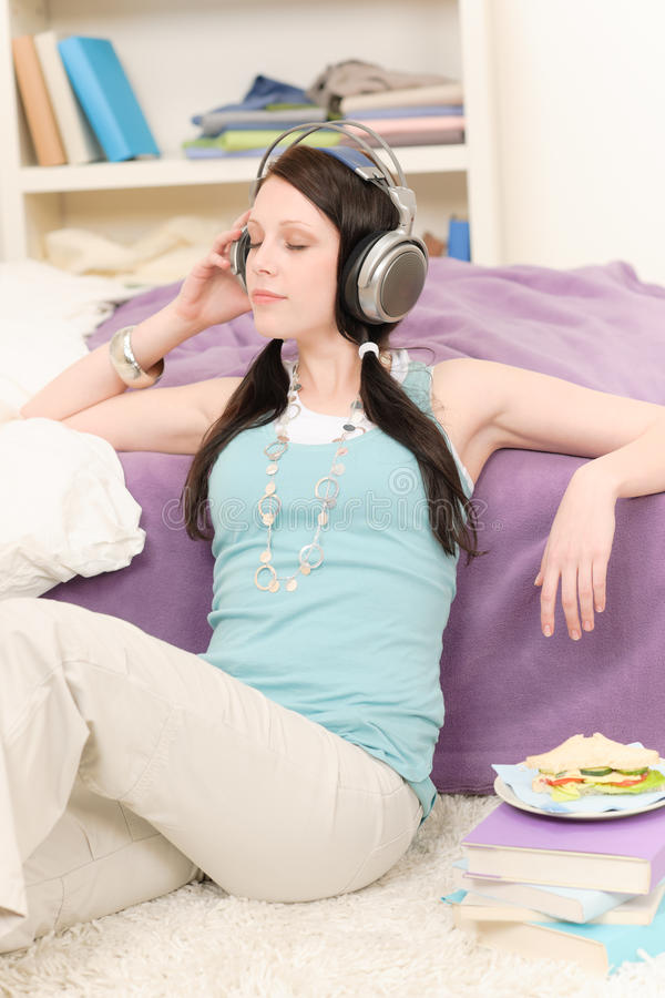 Young happy student relax listen to music