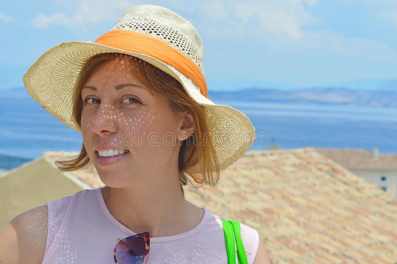 Young happy tanned girl portrait with sea in background stock photos
