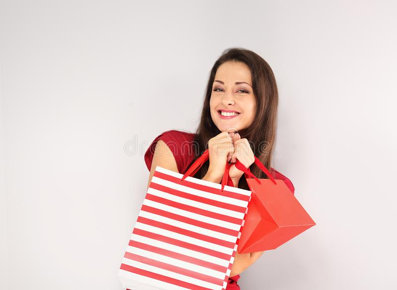 Young happy toothy smiling woman with shopping bags. Happy New Year Holidays stock images